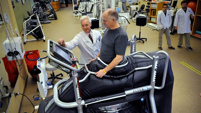 Physical therapist Tom Jensen works with Paul Orndorff in a new anti-gravity treadmill Jan. 29 at St. Cloud Orthopedics Sports Center.