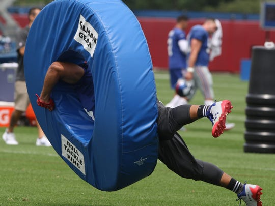 Linebacker Olivier Vernon tackles a dummy as part of