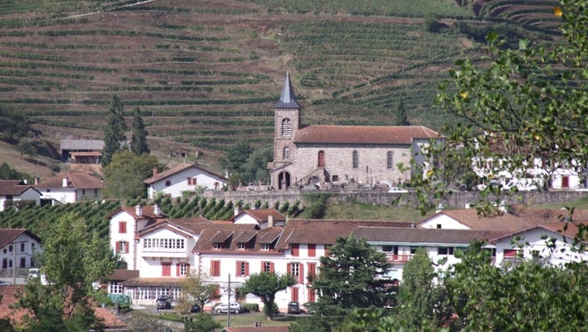 A Catholic church is visible from the terrace of Ray Mouton's home in southwestern France.