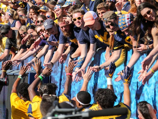 West Virginia Mountaineers students celebrate with
