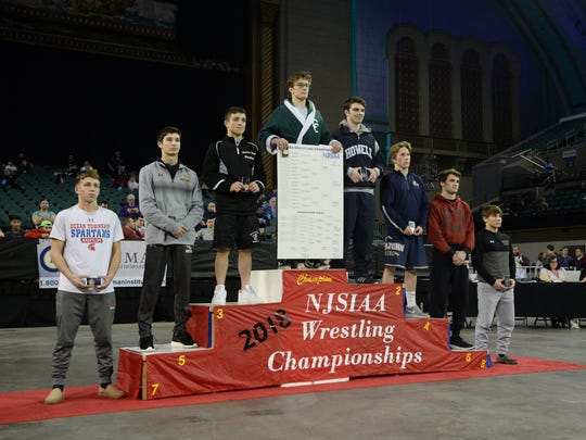 Camden Catholic's Lucas Revano stands atop the podium for the 132-pound weight class in last March's tournament. He will try to win a second state title at 145 pounds in tournament that begins Thursday in Atlantic City.