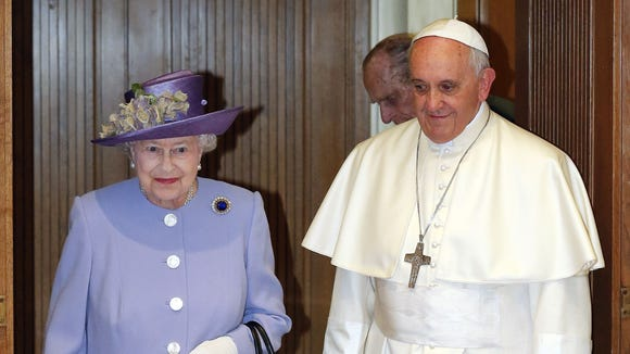 Queen Elizabeth walks with Pope Francis during their