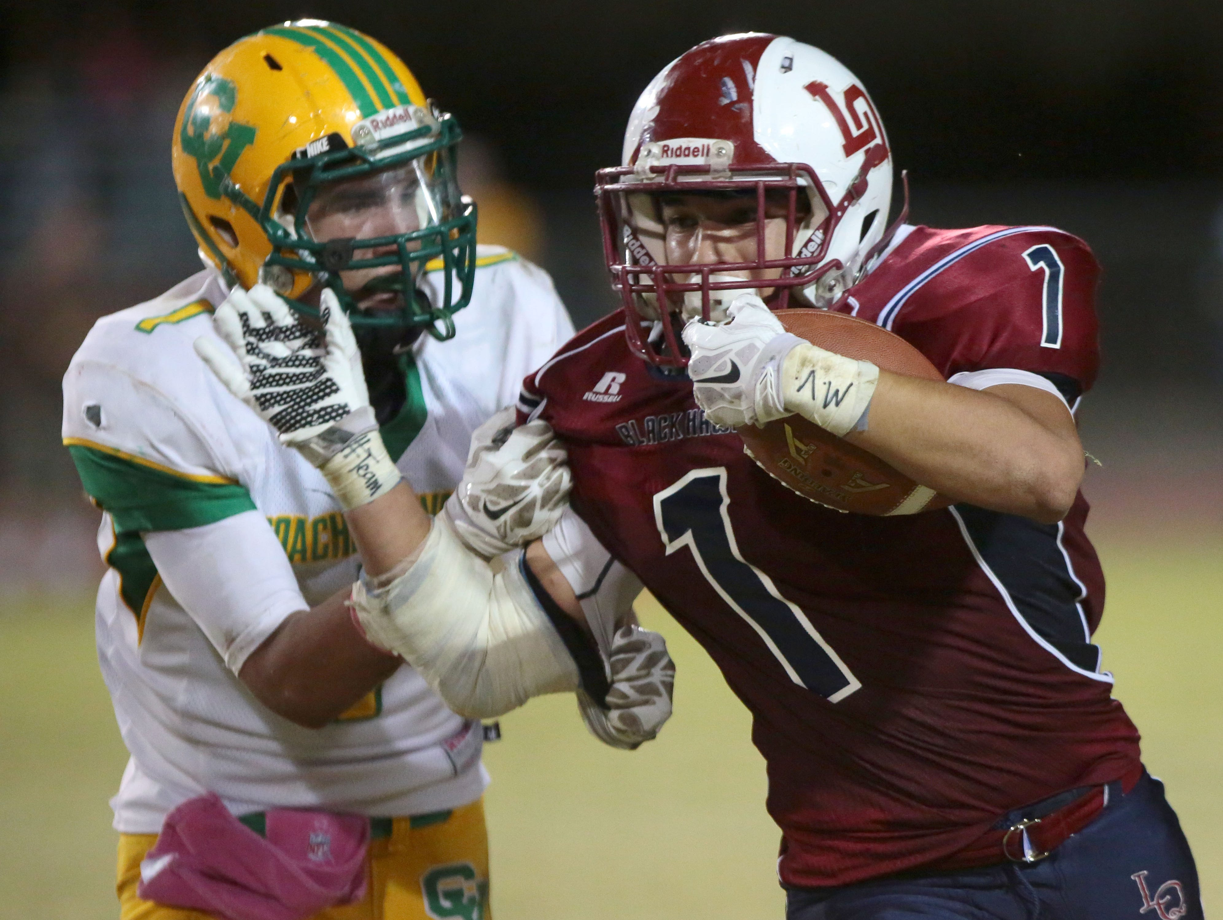 La Quinta's Benji Cordova carries the ball for a first down against Coachella Valley on Friday in La Quinta