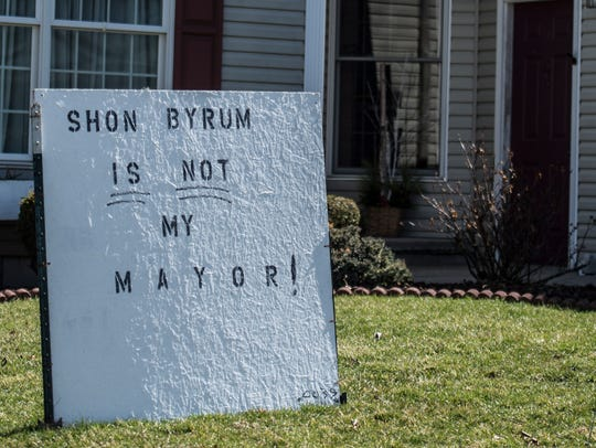 A sign reading 'Shon Byrum is not my mayor' sits in