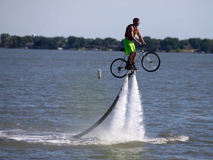 While balancing a bike on a flyboard, Jeff Luft of