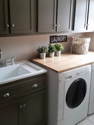 The countertop over the washer and dryer is an Ikea table top cut to size. The cabinet doors were framed with lattice molding to give them a Shaker look.