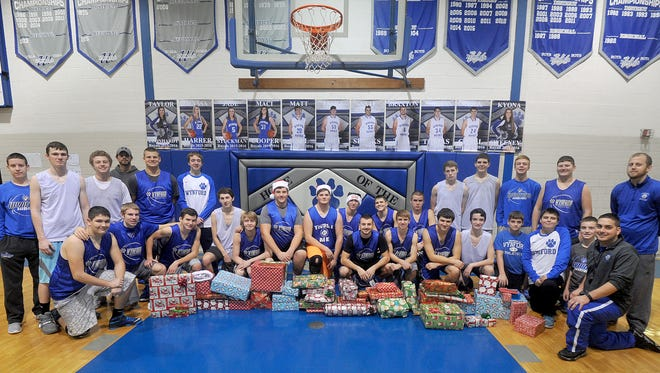 The Wynford boys basketball team adopted a local family and bought them Christmas gifts.