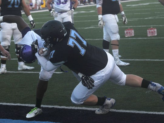 Moorpark College's Cory Price (77) takes down a Cal