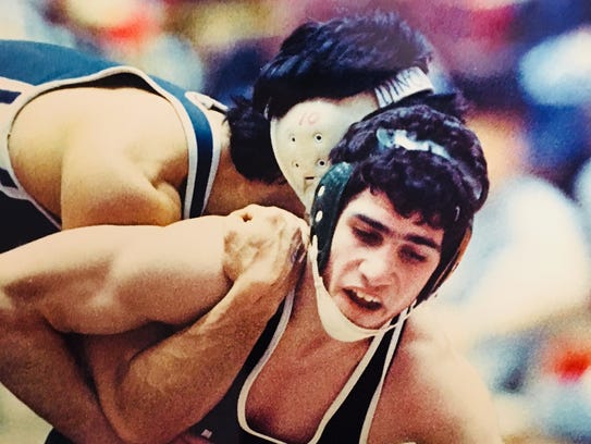 Long Branch's Sam Cole tries to escape against Williamstown's
