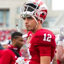 Indiana quarterback Zander Diamont (12) reacts after scoring a touchdown in the second quarter of an NCAA college football game in Bloomington, Ind., Saturday, Oct. 18, 2014. (AP Photo/Sam Riche)
