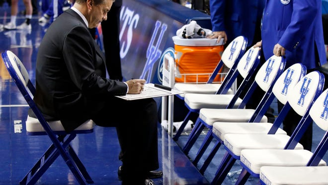 Kentucky head coach John Calipari draws up a play prior to the second half of an NCAA college basketball game against Arizona State Saturday, Dec. 12, 2015, in Lexington, Ky. Kentucky won 72-58. (AP Photo/James Crisp)