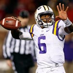 LSU quarterback Brandon Harris (6) readies to pass against Mississippi in the second half of an NCAA college football game in Oxford, Miss., Saturday, Nov. 21, 2015. Mississippi won 38-17. (AP Photo/Rogelio V. Solis)