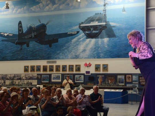 """Judy Bell takes a bow after her performance at last week's of """"Thanks for the Memories - a Tribute to the Troops"""" show at the Palm Springs Air Museum. The show continues on April 9."""