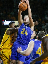 South Dakota State's Mike Daum fights for a rebound