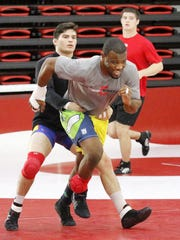 Enock Francois works out with the Cornell University wrestling team on Jan. 21 at the Friedman Wrestling Center in Ithaca.