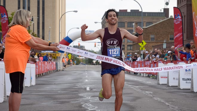Omar Boulama of Walworth finishes the MVP Health Care Rochester Half Marathon in first place for men.