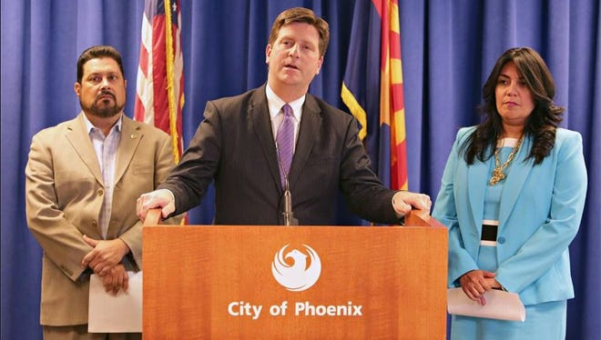Phoenix Mayor Greg Stanton, flanked by District 7 City Councilman Michael Nowakowski and District 4 Councilwoman Laura Pastor, discusses the city's battle with the FAA during a press conference at the mayor's office in Phoenix Wednesday, April 15, 2015.