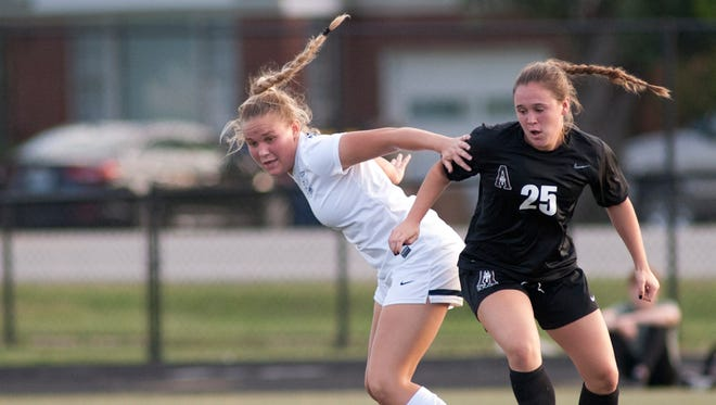 Sacred Heart defender Addy Lancaster tries to keep the ball from Assumption forward Hannah Hennessey. 24 September 2017