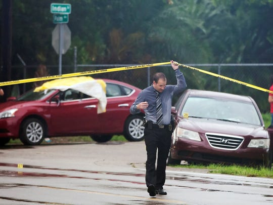 Fort Myers Police officials process the scene of a