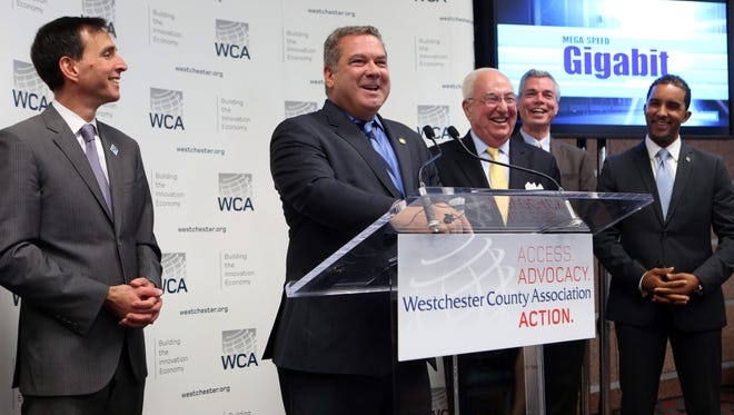 Yonkers mayor Mike Spano speaks about the joint initiative to pursue gigabit broadband with New Rochelle mayor Noam Bramson, left, Bill Mooney, CEO of the Westchester County Association, White Plains mayor Tom Roach and Mount Vernon mayor Richard Thomas, Oct. 6, 2016 in White Plains.