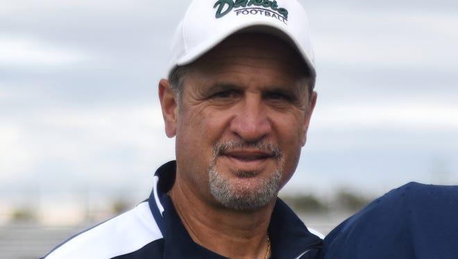 Mike Giannone has been named Warren De La Salle football coach.