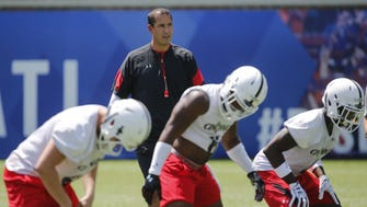 Cincinnati Bearcats head football coach Luke Fickell watches as the linebackers perform drills Wednesday, during the team's first official preseason practice at Nippert Stadium.