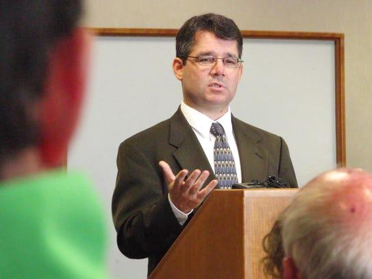 Prosecutor Justin Jiron interviews prospective jurors