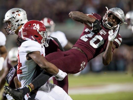 Alabama linebacker Terrell Lewis (24) stops Mississippi