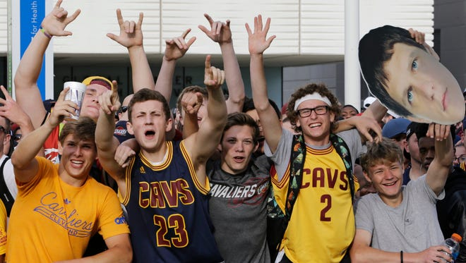 Cleveland Cavaliers fans cheer as they wait for the parade of the NBA basketball team to begin Wednesday, June 22, 2016, in Cleveland. The Cavaliers made history by overcoming a 3-1 deficit to beat the Golden State Warriors in the NBA Finals and end the city's 52-year drought without a professional sports championship.