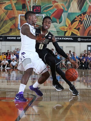 Purdue Boilermakers guard Jon Octeus (0) drives to the basket against the Kansas State Wildcats during the 2014 EA Sports Maui Invitational at the Lahaina Civic Center.
