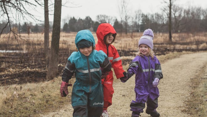 Jessica Featherstone's daughter, Skylar, hikes at the Mequon Nature Preserve with her friends.