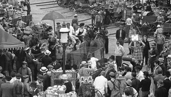 "A block-long stretch of N. 5th St., between Vliet St. and McKinley Ave., is transformed into a 1910 green market for scenes being shot for ""Gaily, Gaily,"" a big-budget Hollywood movie, on June 28, 1968. Seen at top left: the old Ambrosia Chocolate factory. This photo was published in the June 28, 1968, Milwaukee Journal."
