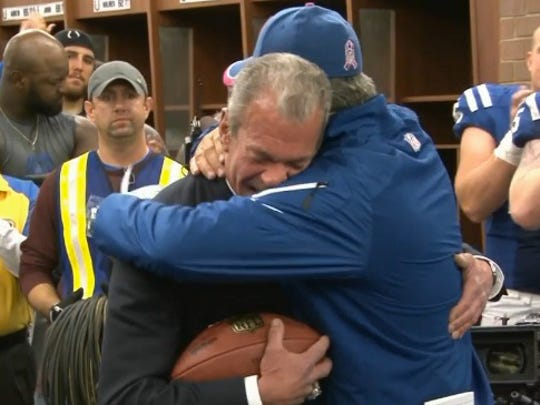 Jim Irsay and Chuck Pagano embrace in the locker room after Sunday's win over Cincinnati.
