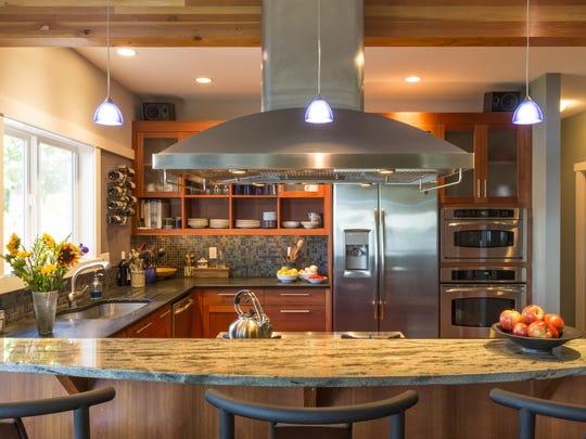 Contemporary upscale home kitchen interior with granite countertops