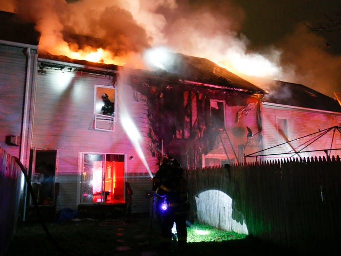 Firefighters work on a two-alarm fire that damaged