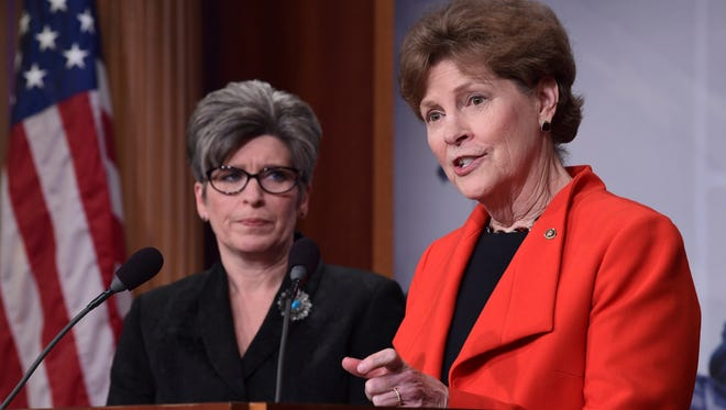 Sen. Joni Ernst (R-Ia.), left, and Sen. Jeanne Shaheen, D-N.H., have announced a bipartisan resolution that would establish a special committee to investigate the USA Gymnastics sex abuse scandal.