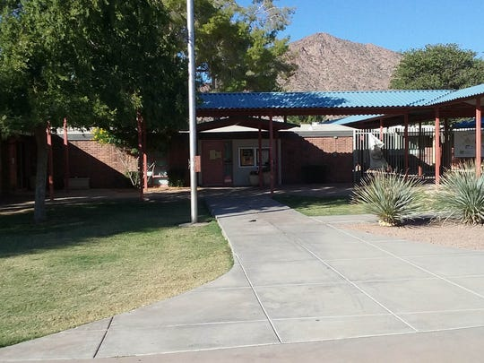 Parents of children at Hopi Elementary School, and residentsnear the Arcadia structure, say the school's new design removeshistorical architecture, weakens thelearning environment and creates a traffic burdenon the rest of the neighborhood.