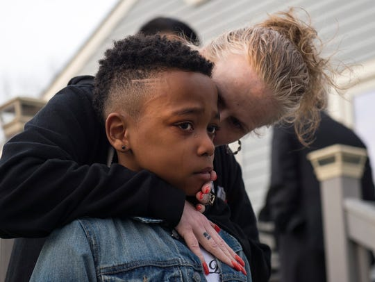 Phillip White's son Tyreese Henschke, 9, is consoled