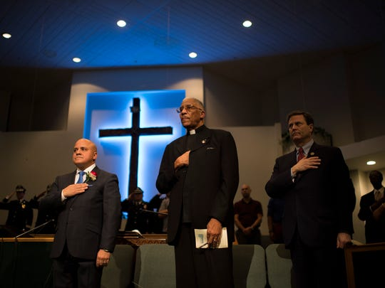 Camden Mayor Francisco 'Frank' Moran, from left, Rev. John O. Parker and Rep. Donald Norcross stand for the National Anthem during an inauguration ceremony Friday, Jan. 12, 2018 at Antioch Baptist Church in Camden, N.J.