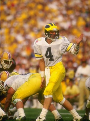Jim Harbaugh quarterbacks Michigan during its loss to Arizona State on Jan. 1, 1987, at the Rose Bowl.