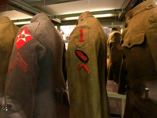 In this Feb. 16, 2017 photo uniforms hang on display at the National World War I Museum in Kansas City, Mo.