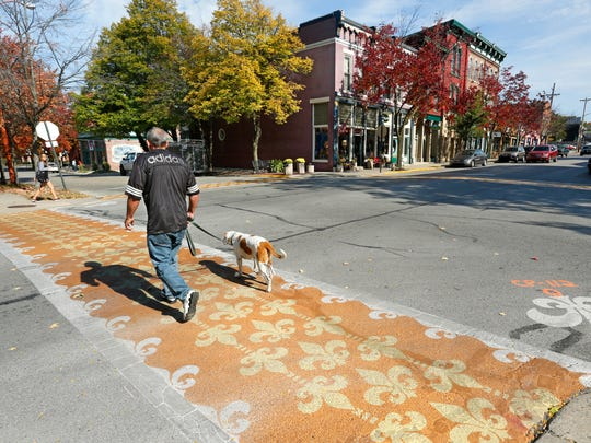 Painted and stenciled crosswalks Wednesday, October 21, 2015, at the intersection of 10th and Main streets in downtown Lafayette. The colorful cross walks are part of Lafayette Arts-Center Stage.