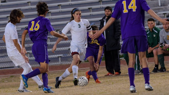 Bailey Deroussel moves between defenders as the Byrd Yellow Jackets travel from Shreveport to face Acadiana Rams soccer team. Feb 16, 2016.