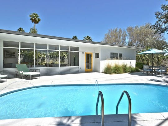The Aluminum House in Movie Colony East neighborhood of Palm Springs, Ca is available to rent through vrbo.com. The 1950s two bedroom and two bathroom home is named the Aluminum House for its steel and aluminum frame construction. The narrow house is flanked on either side by large rows of windows giving you the illusion that you are sitting under a covered patio and not inside. Steve Coddington