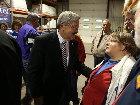 """Gov. Terry Branstad meets with supporters after speaking at Gee Asphalt in Cedar Rapids last Friday. """"The reality is he's happiest when he's out working, when he's out amongst Iowans doing his job as governor,"""" said Jeff Boeyink, a former aide."""