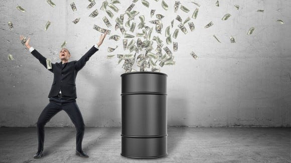 A business person in a suit with arms raised toward the sky stands beside an oil barrel with money shooting out of it into the air.