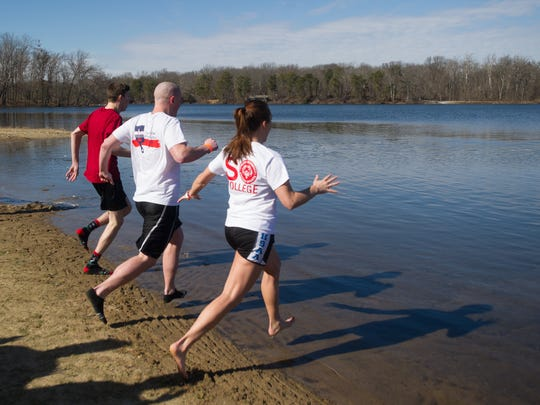 Members of the ÒThatÕs SO ColdÓ team are the first to make the plunge into the icy water at the Polar Plunge fundraiser for Special Olympics Indiana at Scales Lake in Boonville, Saturday, Feb. 4, 2017.