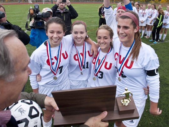 CVU's (from left) Emily Kinneston, Kaelyn Kohlasch, Haliana Buthans and Mackenzie Kingston accept the championship trophy.