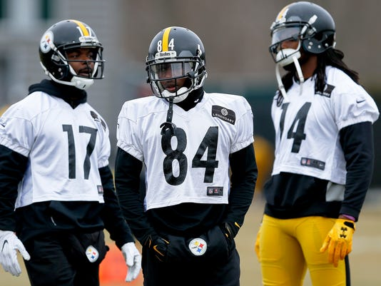 Pittsburgh Steelers wide receiver Antonio Brown (84) stands with other receivers Eli Rogers (17) and Sammie Coates (14) during their NFL football practice, Thursday, Jan. 19, 2017, in Pittsburgh. The Steelers face the New England Patriots in the AFC conference championship on Sunday. (AP Photo/Keith Srakocic)