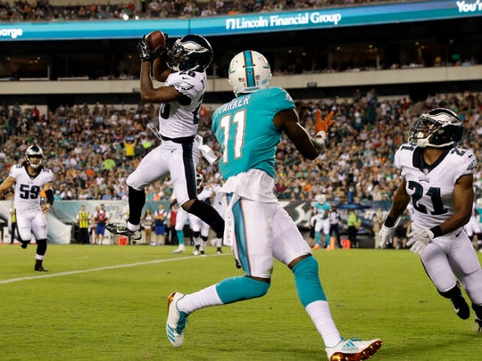 Philadelphia Eagles' Jaylen Watkins (26) pulls in an interception against Miami Dolphins' DeVante Parker (11) during the first half of a preseason NFL football game, Thursday, Aug. 24, 2017, in Philadelphia. (AP Photo/Michael Perez)